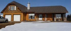 Sided with half log siding to give it that log home look with all the benefits of ICF construction